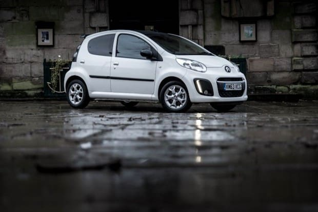 White car on rainy road