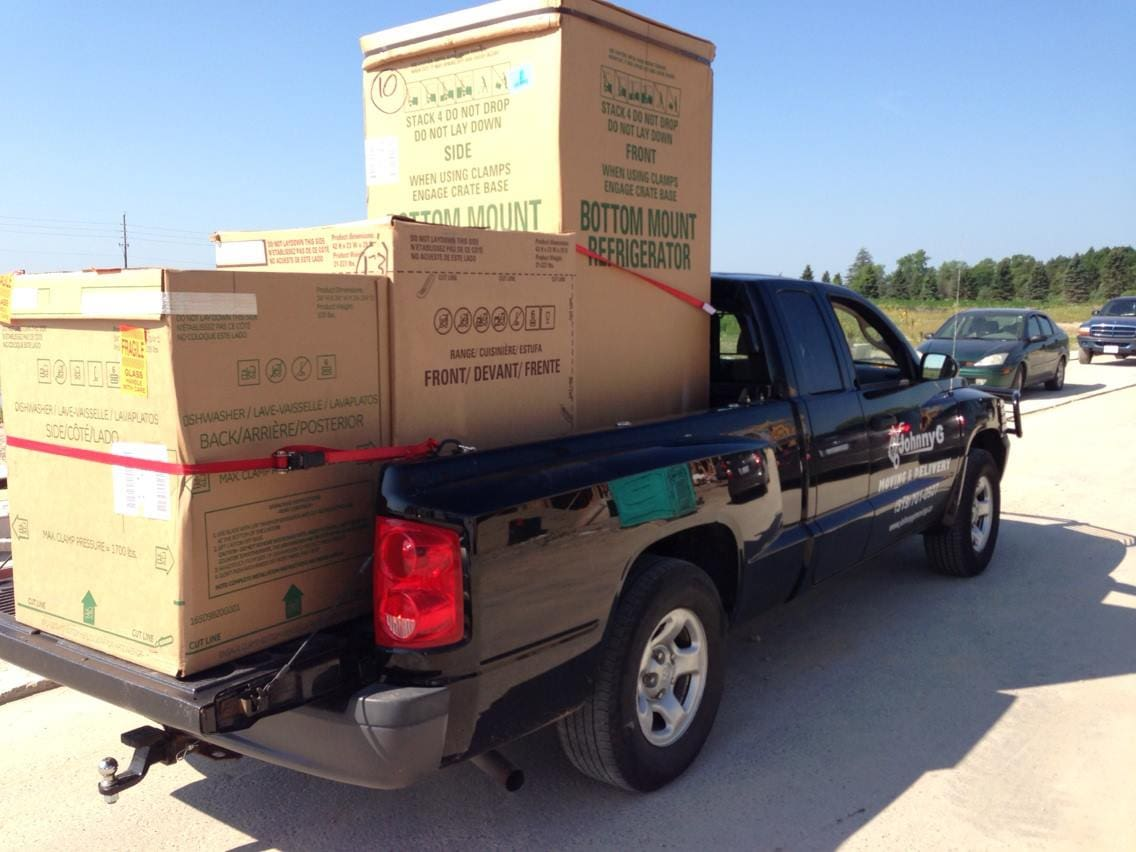 Pickup truck moving boxes