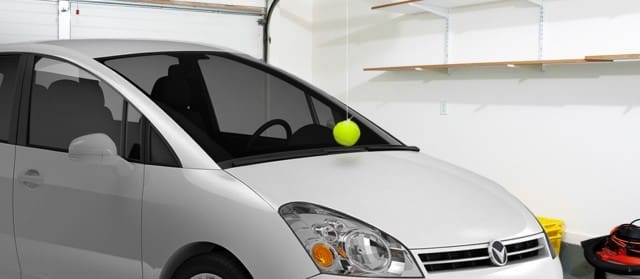 Image on how to put tennis ball to prevent car from hitting wall