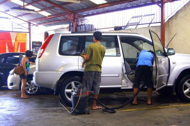 Men cleaning a van at a carwash