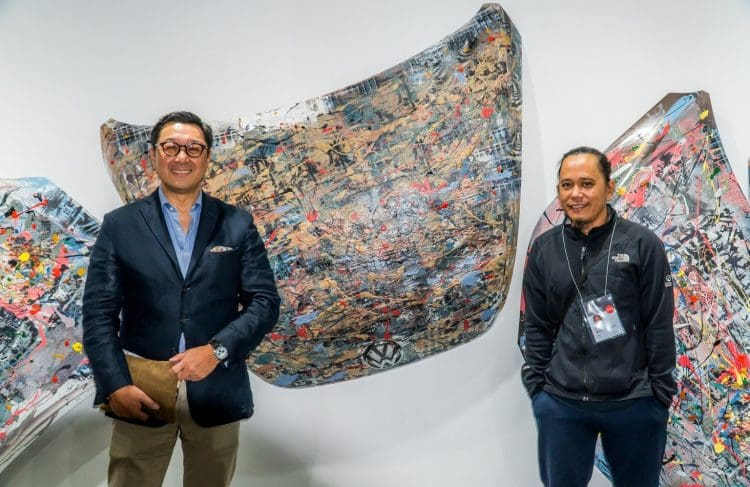 Volkswagen artwork with artist Art Lozano (right) and AC Industrials President and CEO Arthur Tan.