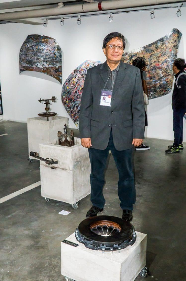 Artist Dan Raralio with Isuzu artworks.