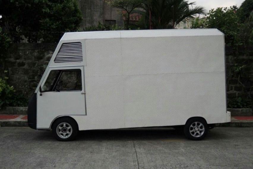 Atoy Llave's isolation facility using Suzuki Super Carry closed van